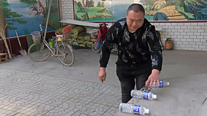 Breaking Dat! Twitter sensation Chinese strongman chugs beer 'tornado' style