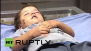 State of Palestine: Mother and daughter airstrike victims at Gazan morgue *GRAPHIC*