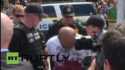 USA: 'Blood-stained' anti-Castro protester arrested outside new Cuban Embassy