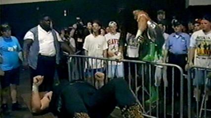 Sabu drives Cactus Jack through a table at ECW Hostile City Showdown 1994