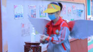 Chinese school students return to classes with DIY 'wings' to keep social distance