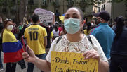 Spain: Demonstrators show solidarity with Colombian anti-govt protests at Barcelona rally