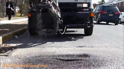 Машина за запълване на дупки на пътя