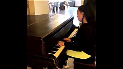 Demi play on piano