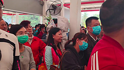 Macao: Passengers mask up as first case of coronavirus confirmed in region