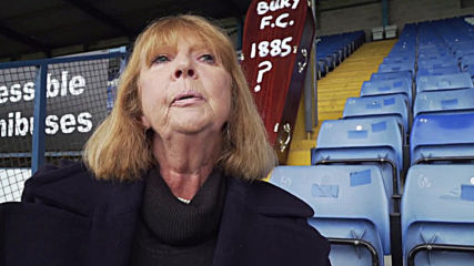 UK: Ex-Bury FC director handcuffs herself to railings outside stadium