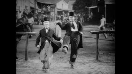 Лаурел и Харди танцуват