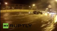 Russia: Daredevils SURF on flooded Vladivostok roads
