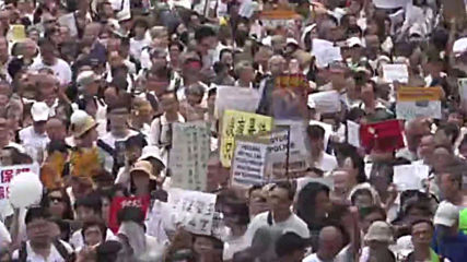 Hong Kong: Thousands march in Hong Kong calling for general strike