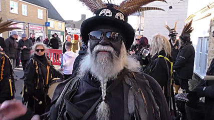 Cambridgeshire town residents paint their faces black for Straw Bear Festival