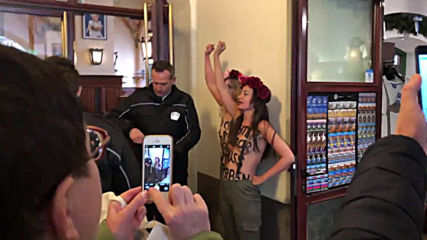 Germany: Femen activists protest in beer hall where Nazi party was founded 100 years ago