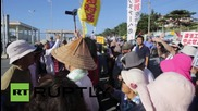 Japan: Protesters rally outside US Marine Corps facility