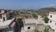 Syria: Drone captures the ruins of Kinsabba after government forces retake town