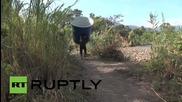 Colombia: Migrants cross Venezuelan border back to homeland