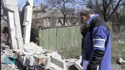 Fighting Rages in Eastern Ukraine Despite New Weapons Pullback Deal