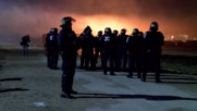 France: Fiery clashes rage in Calais as sun sets on mass eviction
