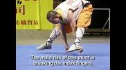 Shaolin Monk Balances On 2 Fingers2