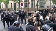 Streaking striker strikes with strings at Paris anti-labour reform demo