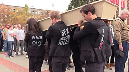 Germany: FEMEN stage 'funeral' outside erotic fair in Berlin *EXPLICIT*