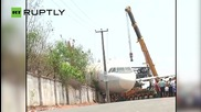 Plane Falls on Private House Following Crane Collapse