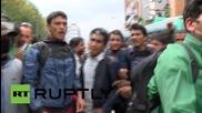 Nepal: Desperate crowd turns on police after bus ticket failurex