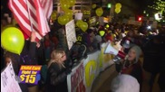 USA: Hundreds of 'Fight for $15' activists march on GOP debate