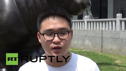 China: Xiamen's answer to the Wall Street Bull? Residents pray for market upturn