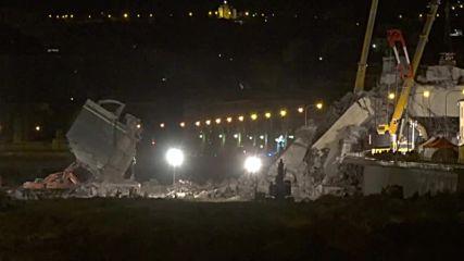 Italy: Bulldozers demolish unsafe portion of collapsed bridge