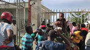 Haiti: Deported from US, angry migrants await documents and compensation at Port-au-Prince airport