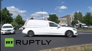 Germany: White hearses carry Germanwings student victims' bodies home