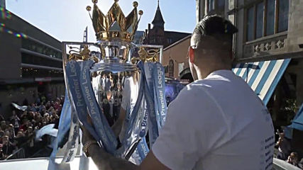 UK: Sun-soaked City stars parade through Manchester in open-top bus