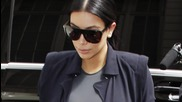 Kim Kardashian Shows off Growing Baby Bump in Tight, Plunging Outfits