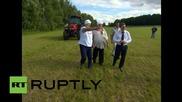 Belarus: Lukashenko gives Gerard Depardieu a master class in scything