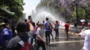 Chile: Water cannon deployed as unions march in Santiago