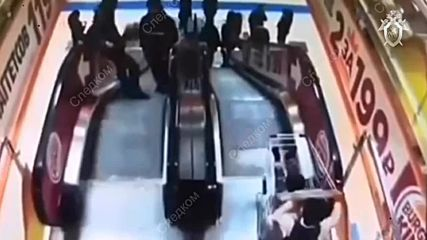 Russia: CCTV captures moment boy sends little brother down an escalator in shopping cart