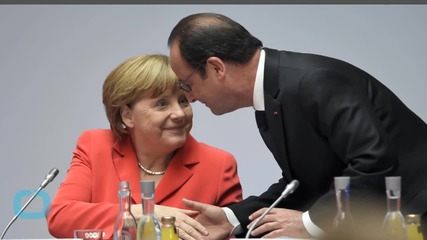 Hollande, Merkel Call for Implementation of Minsk Agreement