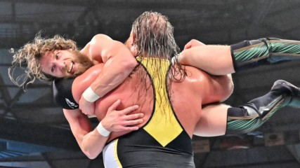Heavy Machinery overpower Daniel Bryan with a stalling suplex: WWE Stomping Grounds 2019 (WWE Network Exclusive)