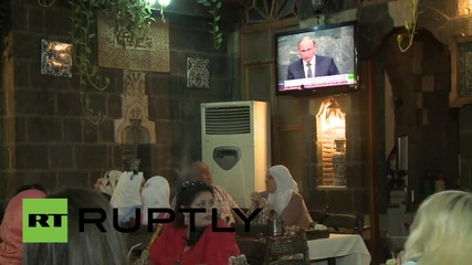 Syria: Putin supporters watch his UNGA address from Damascus