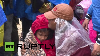 Croatia: Refugees brave the rain in Bapska after crossing from Serbia