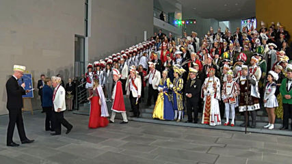 Germany: Chancellor Merkel welcomes 'royal Carnival couples' to her office