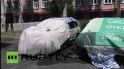 Ukraine: Donetsk protesters burn OSCE vehicles