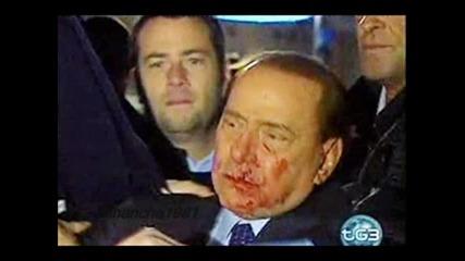Mъж удари с юмрук премиера на Италия Силвио Берлускони