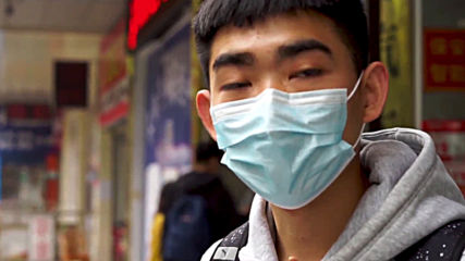 China: Restrictions eased in Hubei province as government says coronavirus cases drop