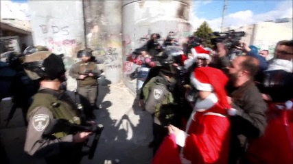 State of Palestine: 'Santas' clash with Israeli troops in Bethlehem, at least 14 hurt