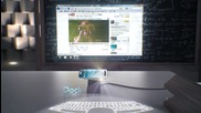 Смартфон на бъдещето прожектира екран и клавиатура