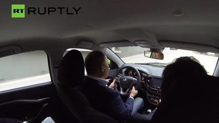 Putin takes to the wheel of the new Lada Vesta!