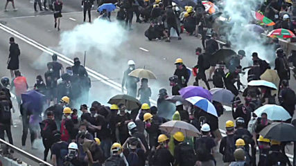Hong Kong: Police respond to firebombs with water cannon as violence escalates