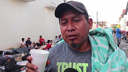 Mexico: Migrant caravan seen washing clothes in river and sleeping in streets of Huixtla