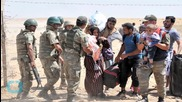 Thousands Flee Into Turkey From Syria as Kurds Fight Islamic State