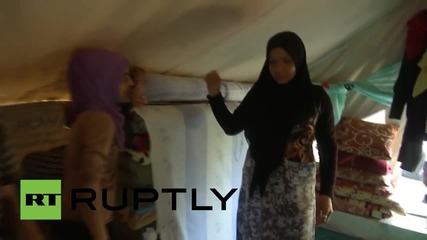 Syria: 6,000 refugees take shelter in old football stadium in Latakia